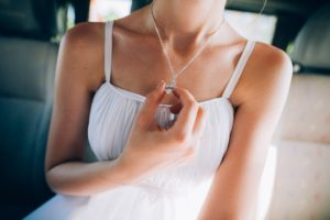 Woman holding her diamond necklace
