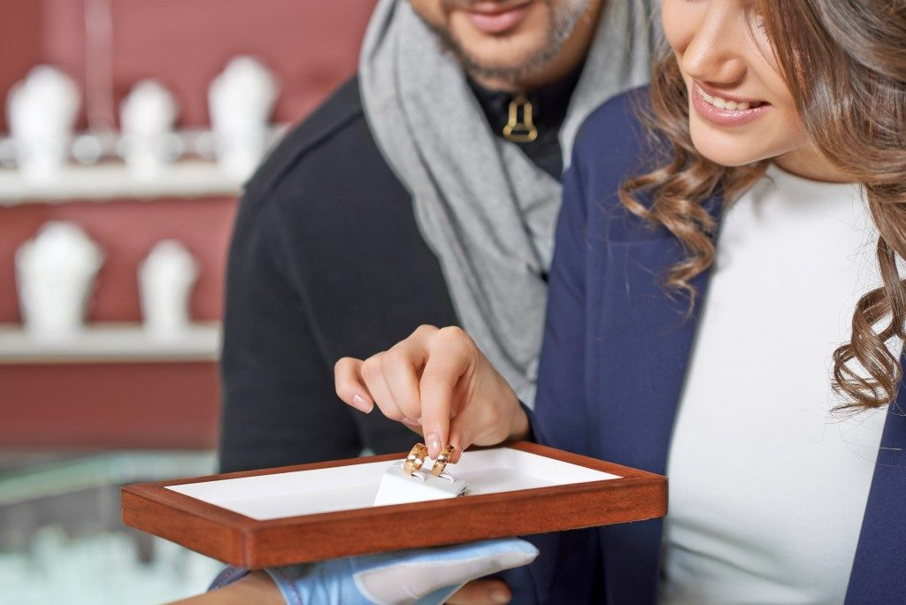 Couple buying wedding ring