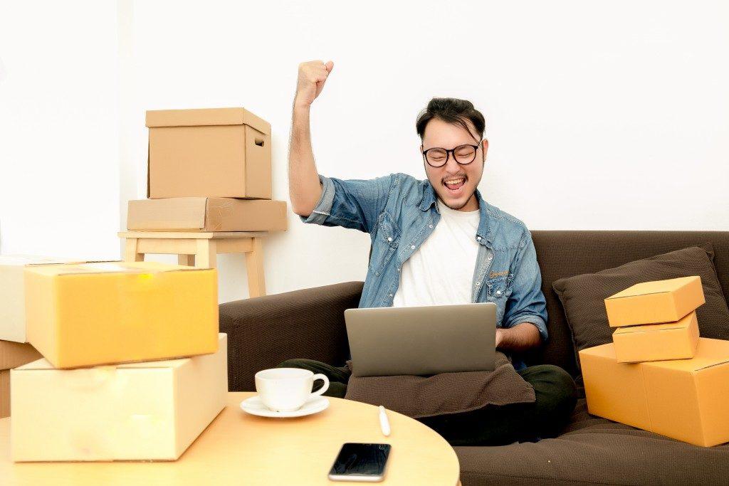 man enjoying online shopping