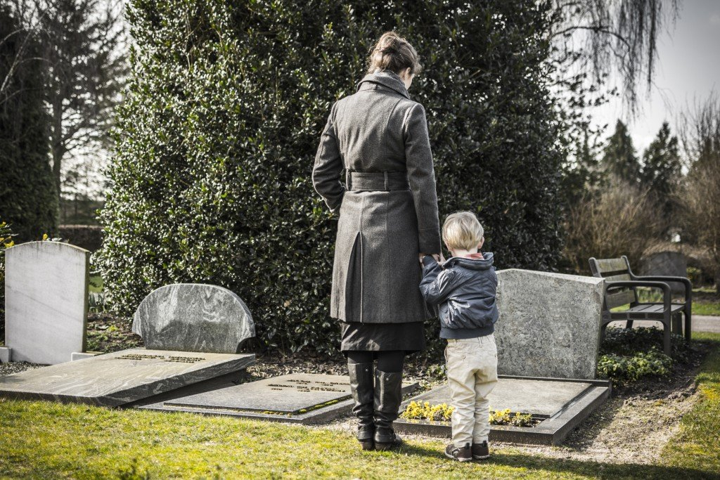 Woman with child at graveyard