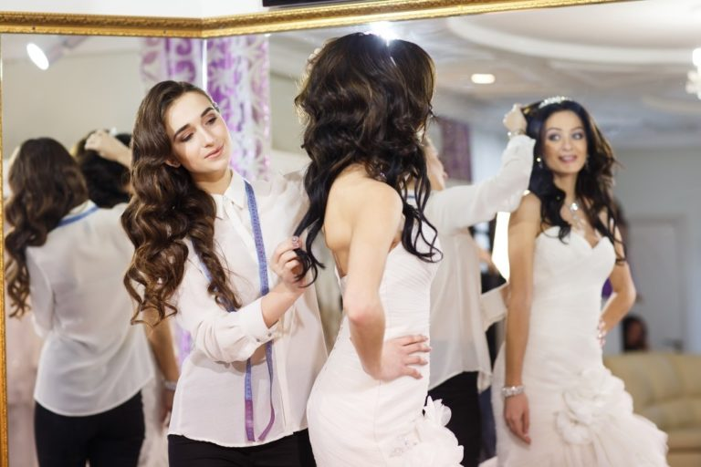 Female trying on wedding dress
