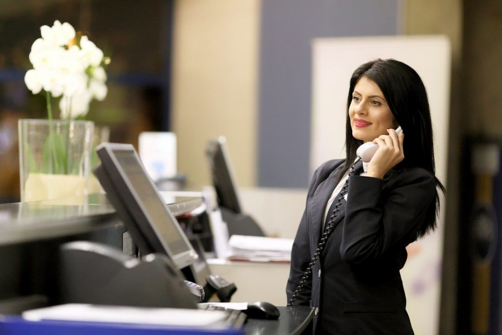 receptionist taking a call