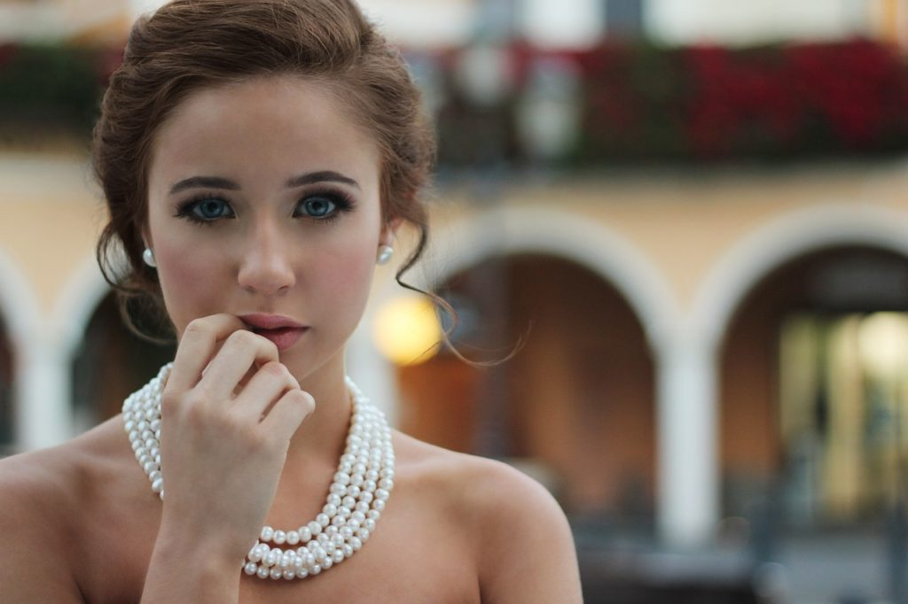 attractive woman wearing a pearl necklace