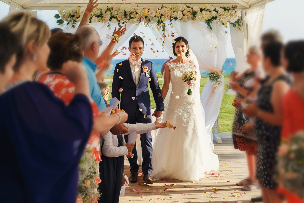 smiling newlyweds on the luxury outdoor wedding ceremony