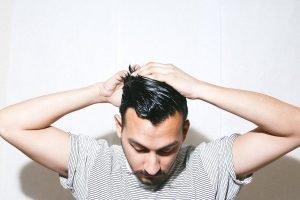 man smoothing back his hair