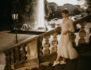 woman in a dress by the stairs