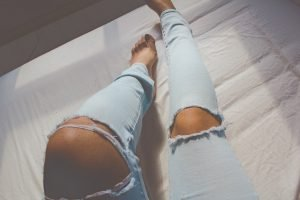 woman wearing ripped jeans