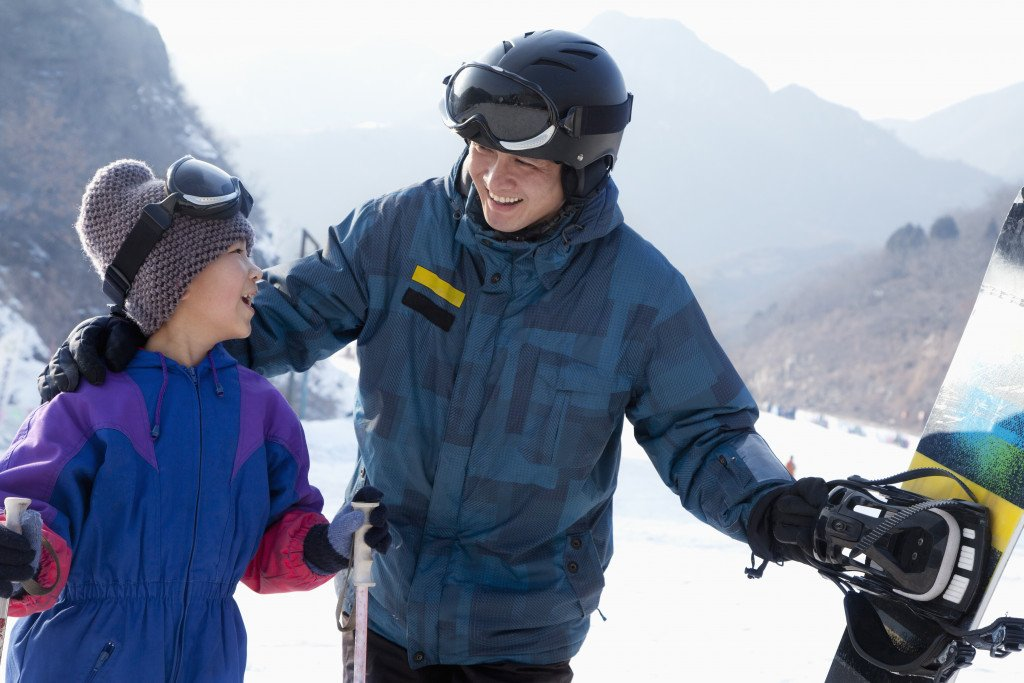Man and Daughter Skiing