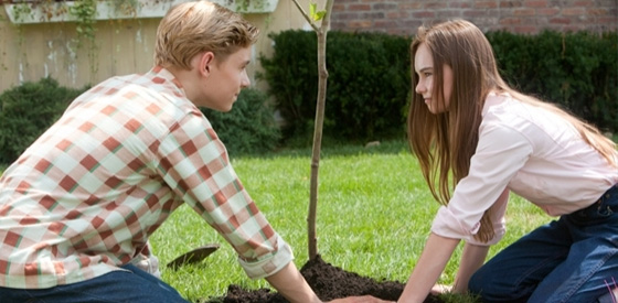 Bryce and Julie planting a tree