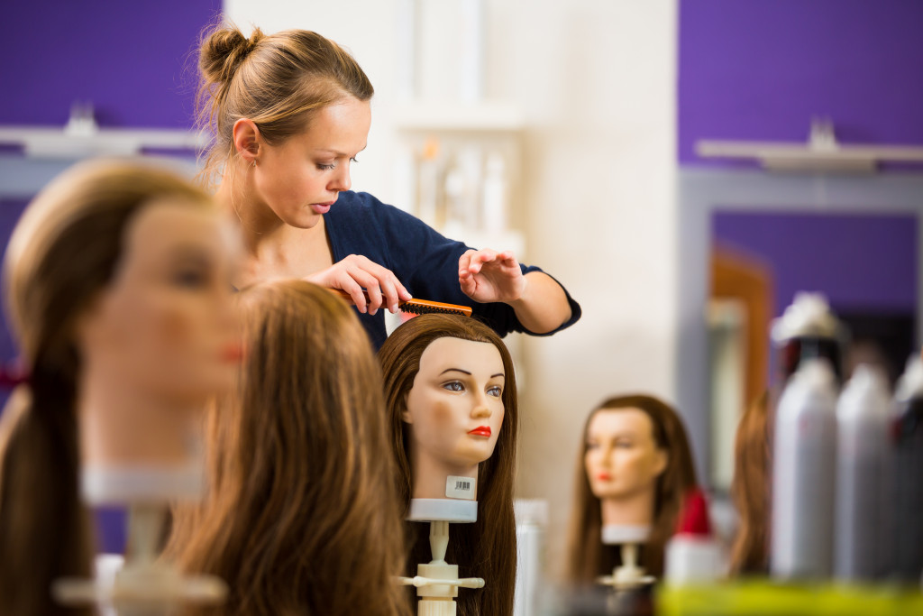 woman working with wigs