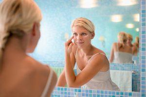 woman applying anti aging cream